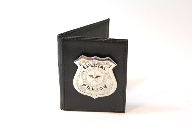 Politie badge in portemonnee